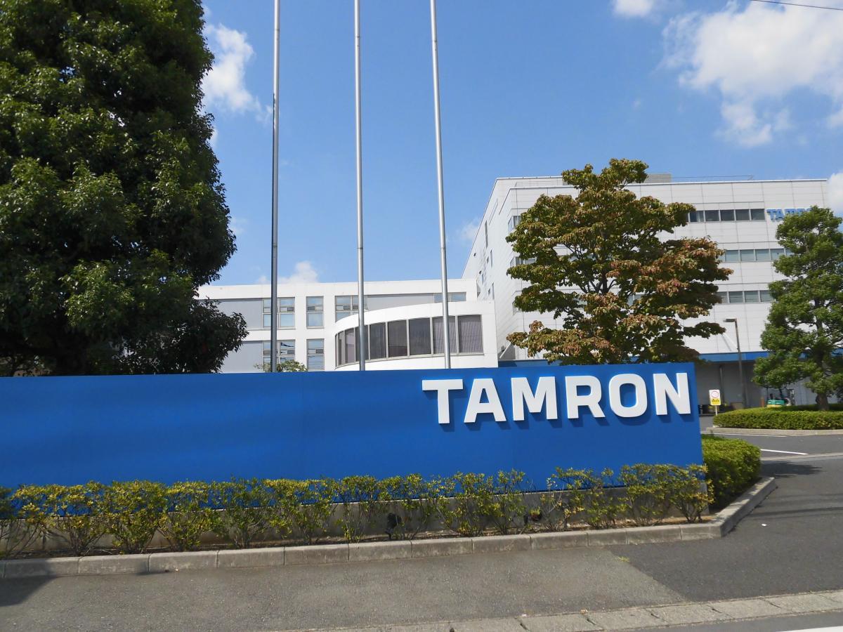 (株)タムロン